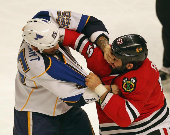 Stewart and Bollig play not so nice. (Photo via Blackhawks Facebook)
